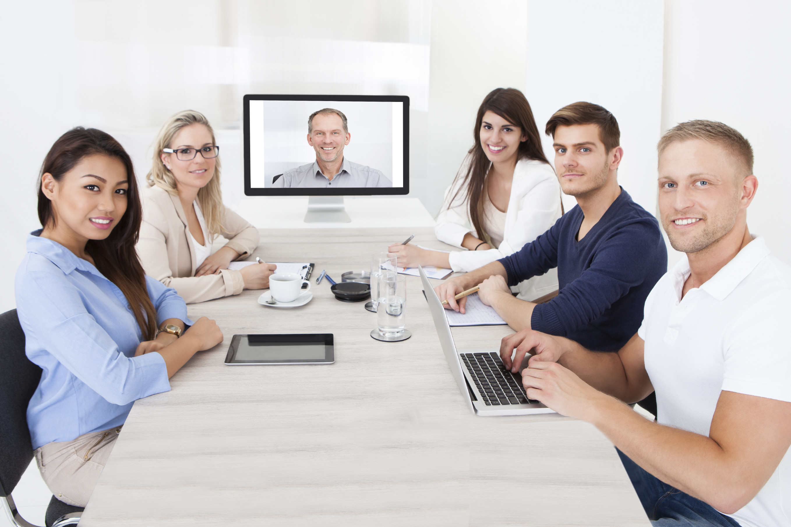 Business-Team-Attending-Video-Conference