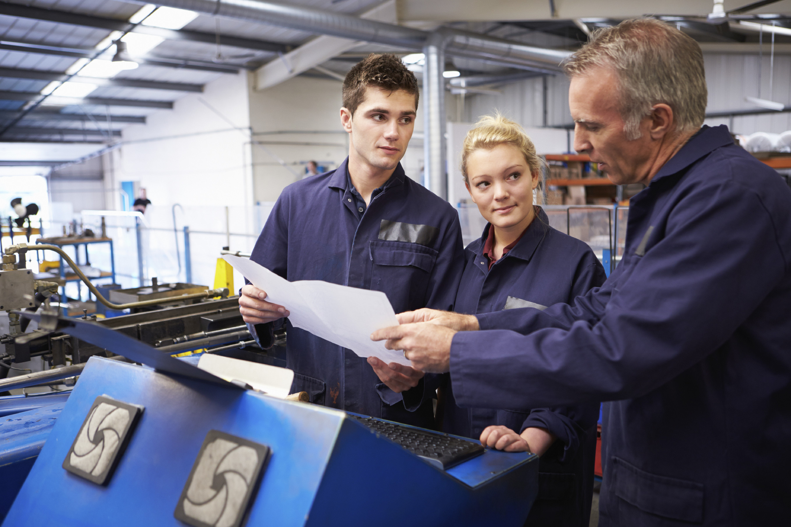 Engineer-Teaching-Apprentices-To-Use-Tube-Bending-Machine